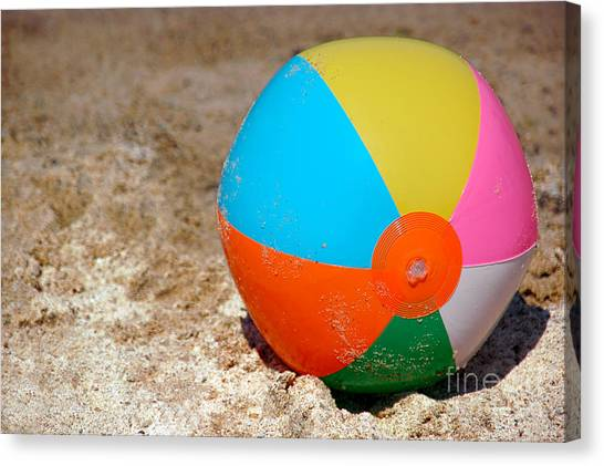 Inflatable Canvas Print - Beach Ball On Sand With Copy Space by Paul Velgos