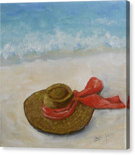 Beach Hat In The Sand Canvas Print by Barbara Harper