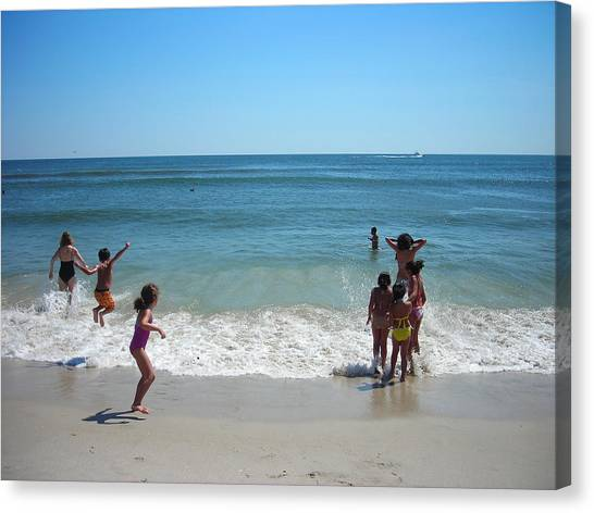 Beach Play Canvas Print by Ruth Sharton