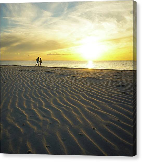 Beach Silhouettes And Sand Ripples At Sunset Canvas Print