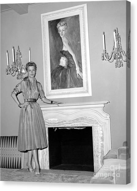 Beauty, Betty Furness, Poses With Her Likeness Behind Her. 1956 Canvas Print by Anthony Calvacca