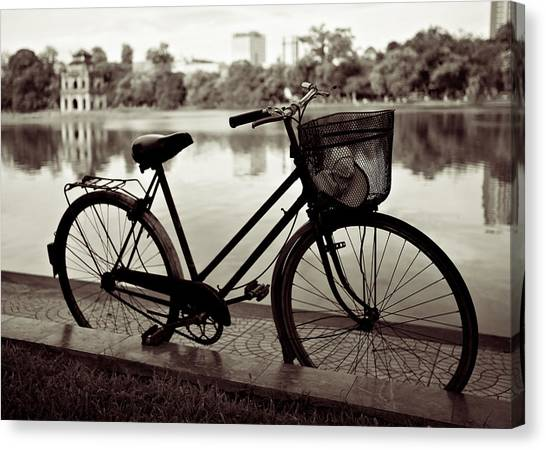 Vietnamese Canvas Print - Bicycle By The Lake by Dave Bowman