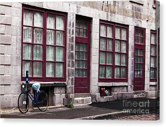Bicycle In Old Montreal Canvas Print by John Rizzuto