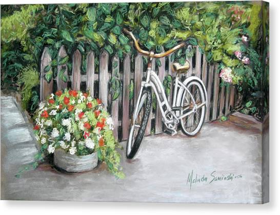 Bicycle On Fence Canvas Print by Melinda Saminski