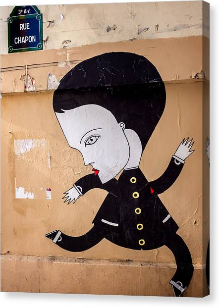 Big Head On Rue Chapon Canvas Print