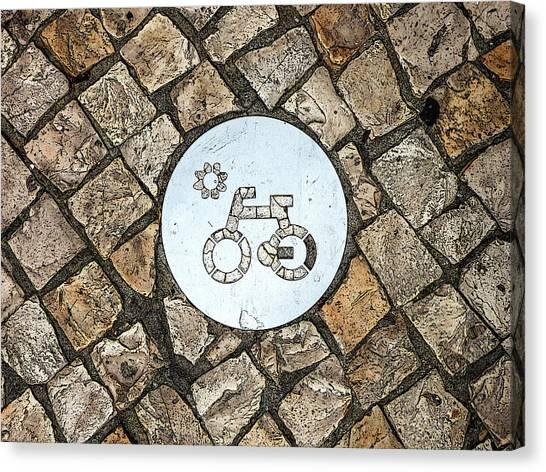 Bike Path Sign On A Cobblestone Pavement Canvas Print