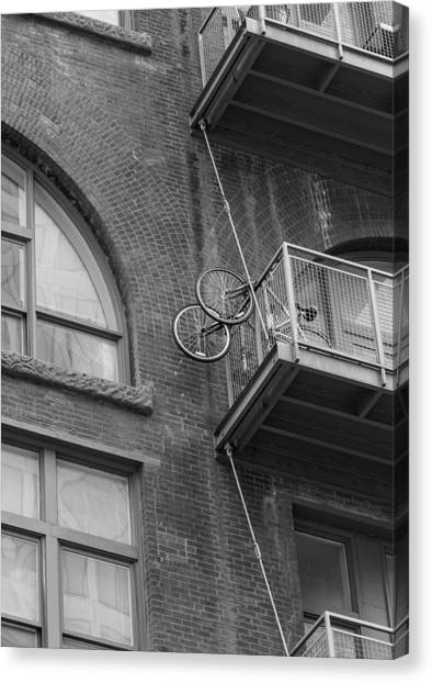 Bikes On Balcony Canvas Print by Denise McKay