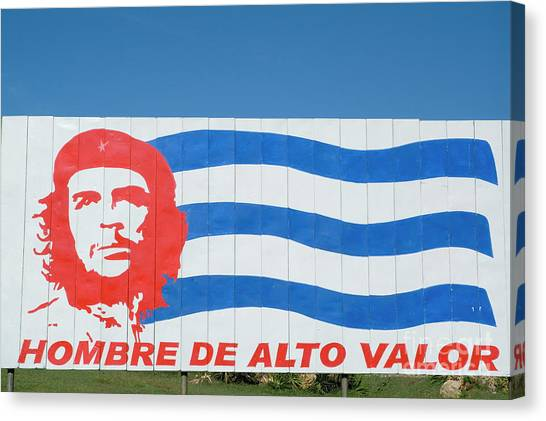 Billboard With The Iconic Che Guevara Portrait And National Cuban Flag Canvas Print by Sami Sarkis