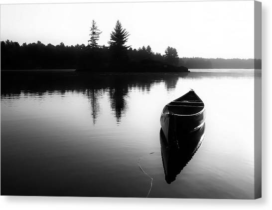 Black And White Canoe In Still Water Canvas Print
