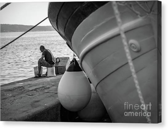 Black And White - Fisherman Cleaning Fish On Docks Of Kastel Gomilica, Split Croatia Canvas Print