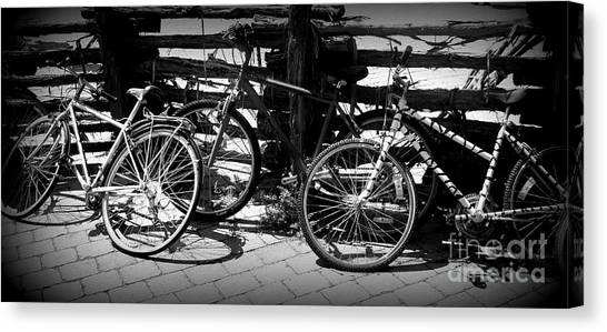 Black And White Leaning Bikes Canvas Print by Emily Kelley