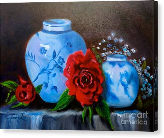 Blue And White Pottery And Red Roses Canvas Print