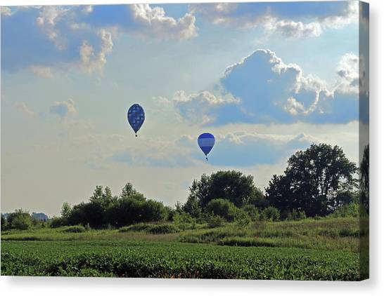 Canvas Print featuring the photograph Blue Balloons Over A Field by Angela Murdock