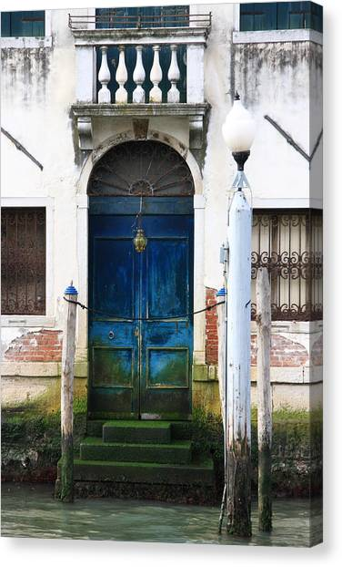 Blue Door On Grand Canal In Venice Canvas Print by Michael Henderson