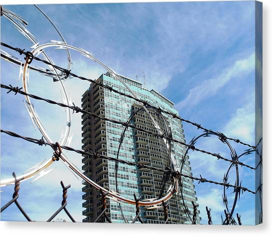 Blue Sky And Barbed Wire Canvas Print