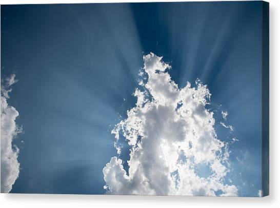 Blue Sky With White Clouds And  Sun Rays Canvas Print