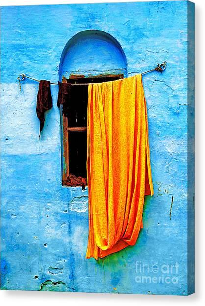 Blue Wall With Orange Sari Canvas Print