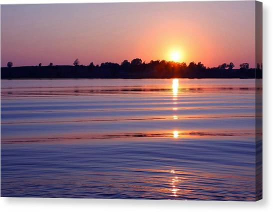 Blue Water Sunset Canvas Print by Jim  Darnall
