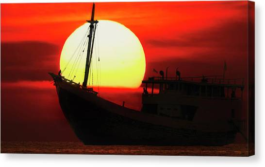Canvas Print featuring the photograph Boatman Enjoying Sunset by Pradeep Raja Prints