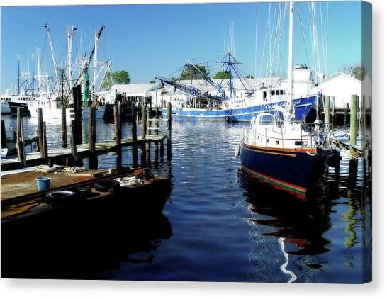 Boats At Orental Canvas Print by Alan Hausenflock