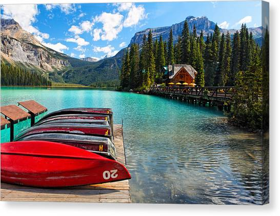 Boats On A Dock  Emerald Lake Canada Canvas Print by George Oze