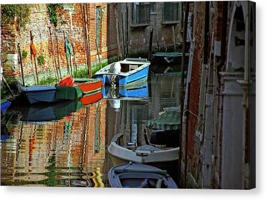 Boats On Canal In Venice Canvas Print by Michael Henderson
