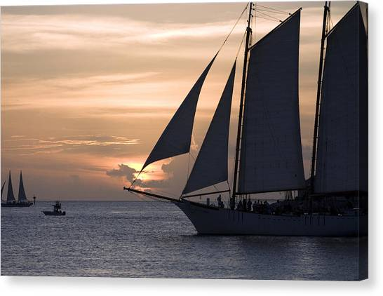 Boats Passing Through Florida Keys Sunset Canvas Print by Christopher Purcell