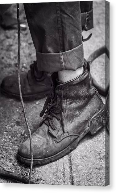 Scuff canvas print boots of a working man by joan carroll