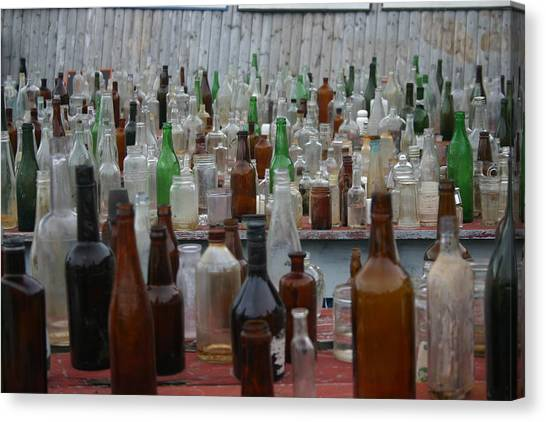 Bottles Canvas Print by Dennis Curry