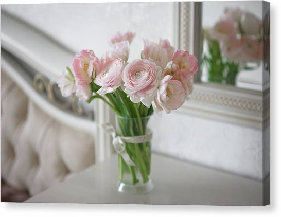 Bouquet Of Delicate Ranunculus And Tulips In Interior Canvas Print