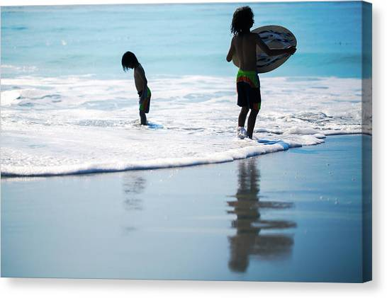 Boy On The Beach With Surf Board,skimboard,and Wave From The Pac Canvas Print