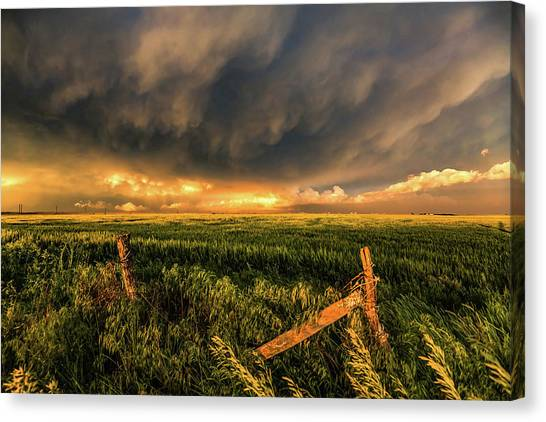 Prairie Sunsets Canvas Print - Breadbasket - Old Fence And Stormy Sky In Kansas by Sean Ramsey