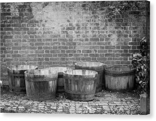 Pavers Canvas Print - Brick Wall And Barrels B W by Teresa Mucha