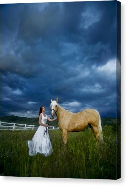 Bride And Horse With Storm Canvas Print by Nick Sokoloff