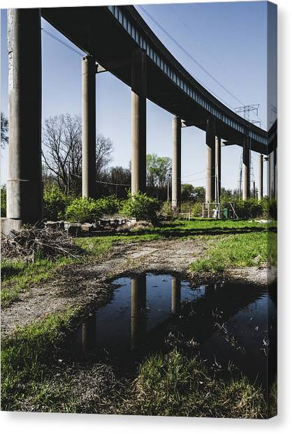 Bridge And Puddle Canvas Print by Dylan Murphy