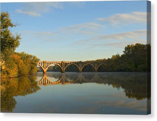 Bridge At Sunrise Canvas Print by John Magor