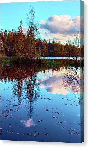 Bright Colors Of Autumn Reflected In The Still Waters Of A Beautiful Forest Lake Canvas Print
