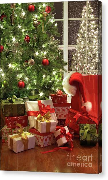 Brightly Lit Christmas Tree With Lots Of Gifts Canvas Print