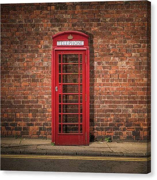 Brexit Canvas Print - British Phone Box Against Red Brick Wall by Mr Doomits