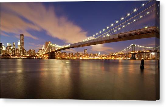 Brooklyn Bridge And Manhattan At Night Canvas Print by J. Andruckow