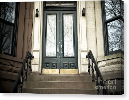 Brownstone Green Door Canvas Print by John Rizzuto