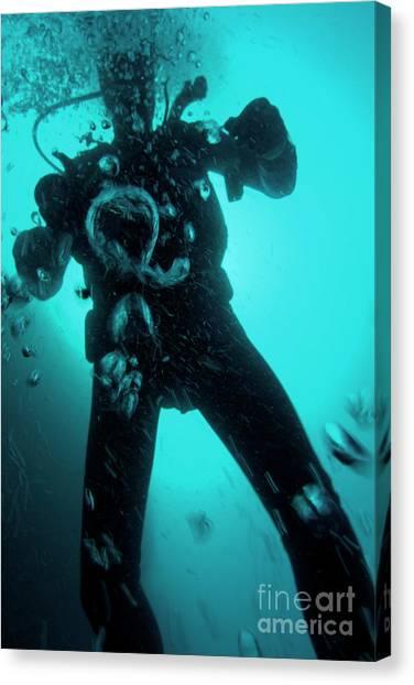 Bubbles Surrounding A Scuba Diver Underwater Canvas Print by Sami Sarkis