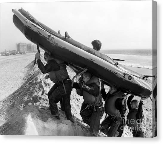 Navy Seal Canvas Print - Buds Students Carry An Inflatable Boat by Michael Wood
