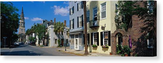 House Of Worship Canvas Print - Buildings Along A Street With A Church by Panoramic Images