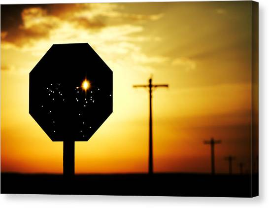 Silhouette Canvas Print - Bullet-riddled Stop Sign by Todd Klassy