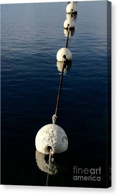 Canvas Print featuring the photograph Buoy Descending by Stephen Mitchell