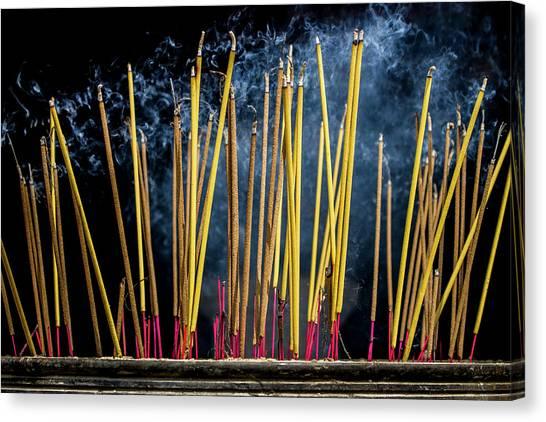 Burning Joss Sticks Canvas Print