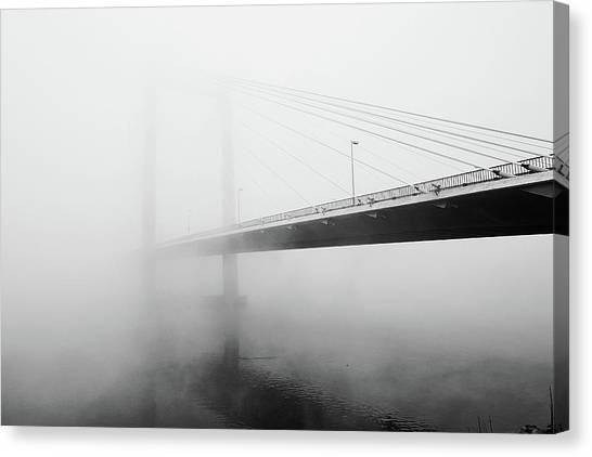 Cable Bridge Disappears In Fog Canvas Print by Photos by Sonja