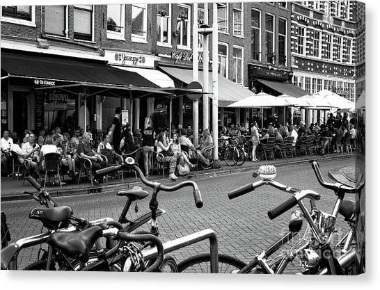 Cafe Crowds In Amsterdam Mono Canvas Print by John Rizzuto