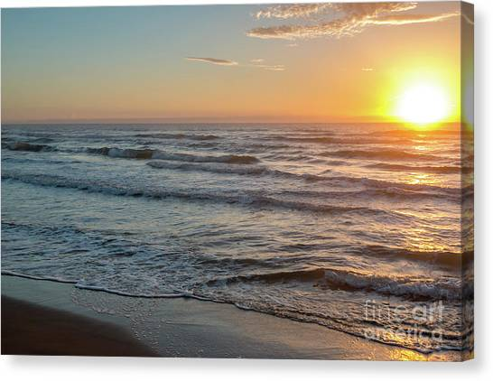 Calm Water Over Wet Sand During Sunrise Canvas Print
